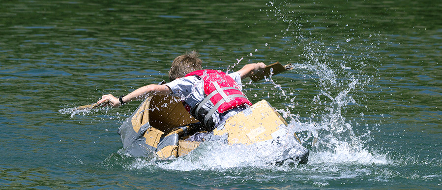 Kid in Cardboard Boat