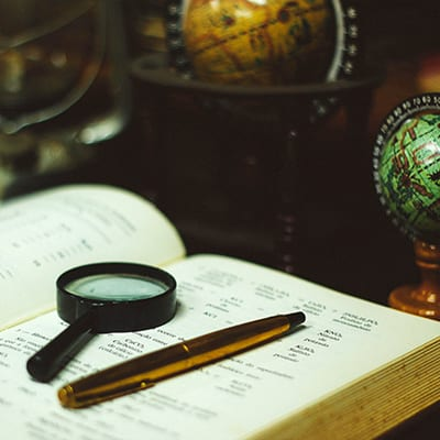 A Magnifying Glass and a Globe