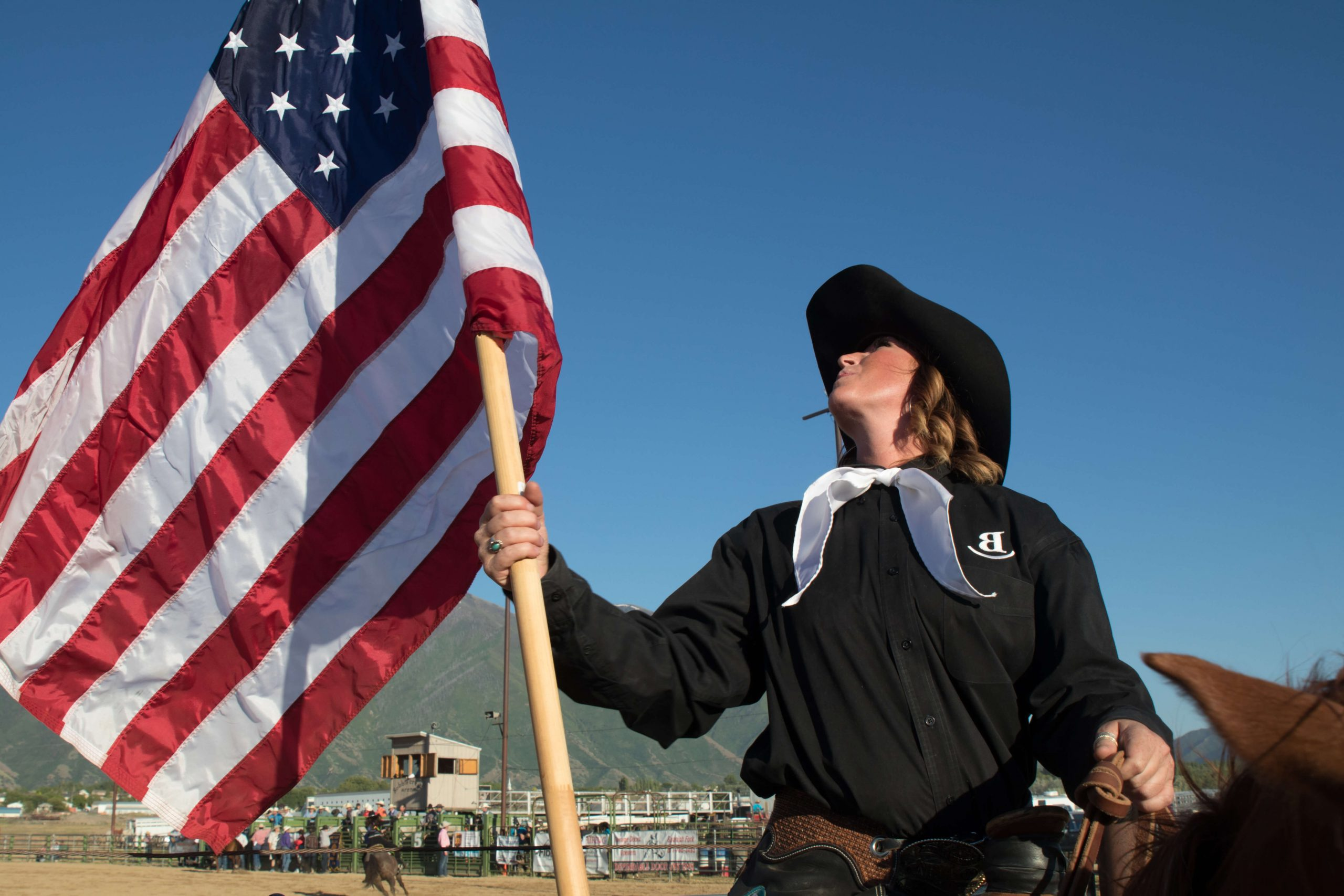 Woman on a Horse Holding the American Flag